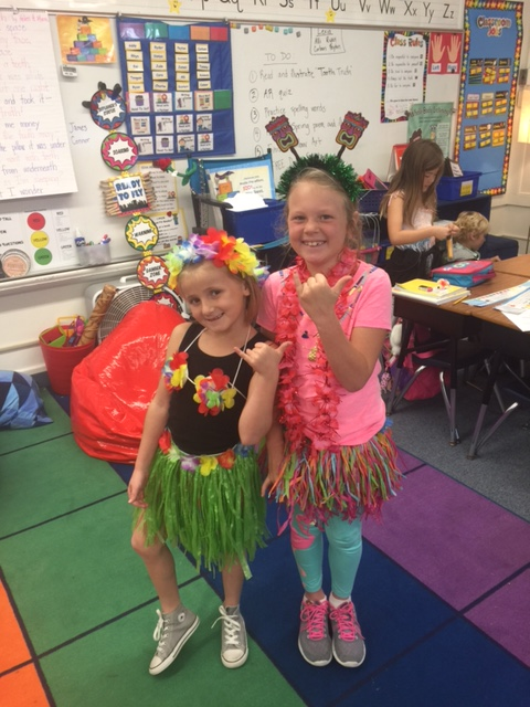 Kids decked out in their hula outfits at school last week. — Photo courtesy Dena Baron , co-chair of Newport El School Foundation ©