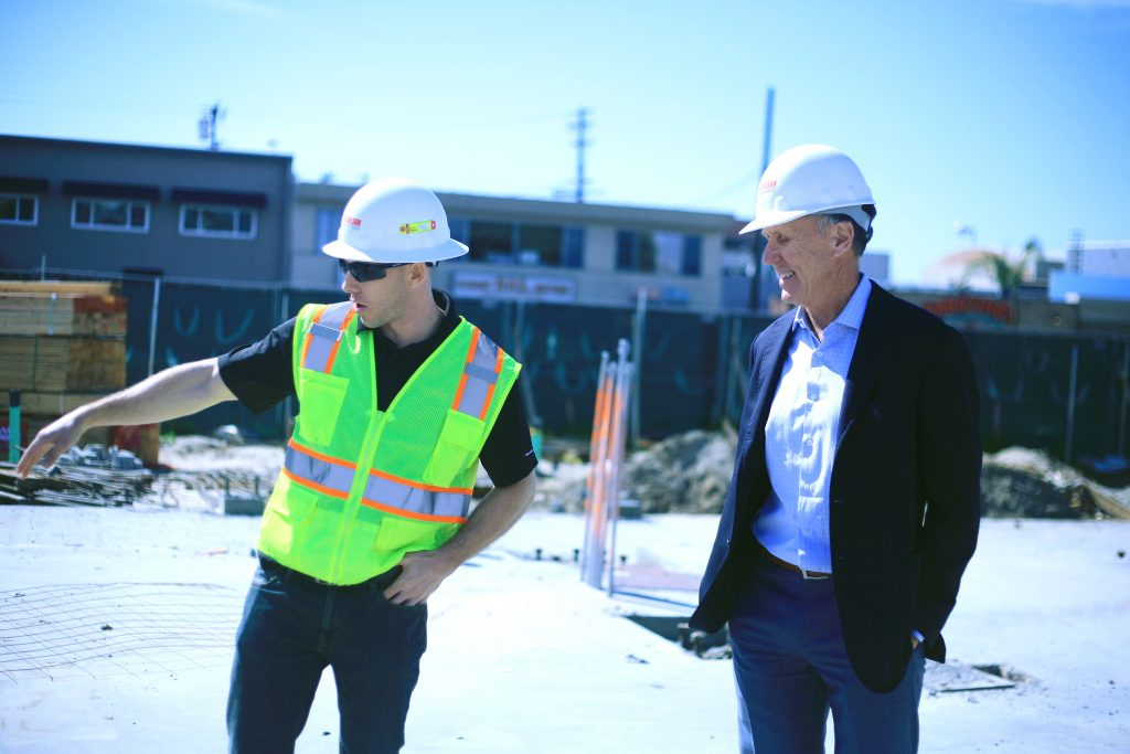 Bob Olson (right), President & CEO of R.D. Olson Development, and Jeremy Dunn, Project Engineer for Lido House Hotel, explain some of the features of the boutique hotel that is part of the overall revitalization plan for Lido Village and the Balboa Peninsula. — Photo by Sara Hall ©