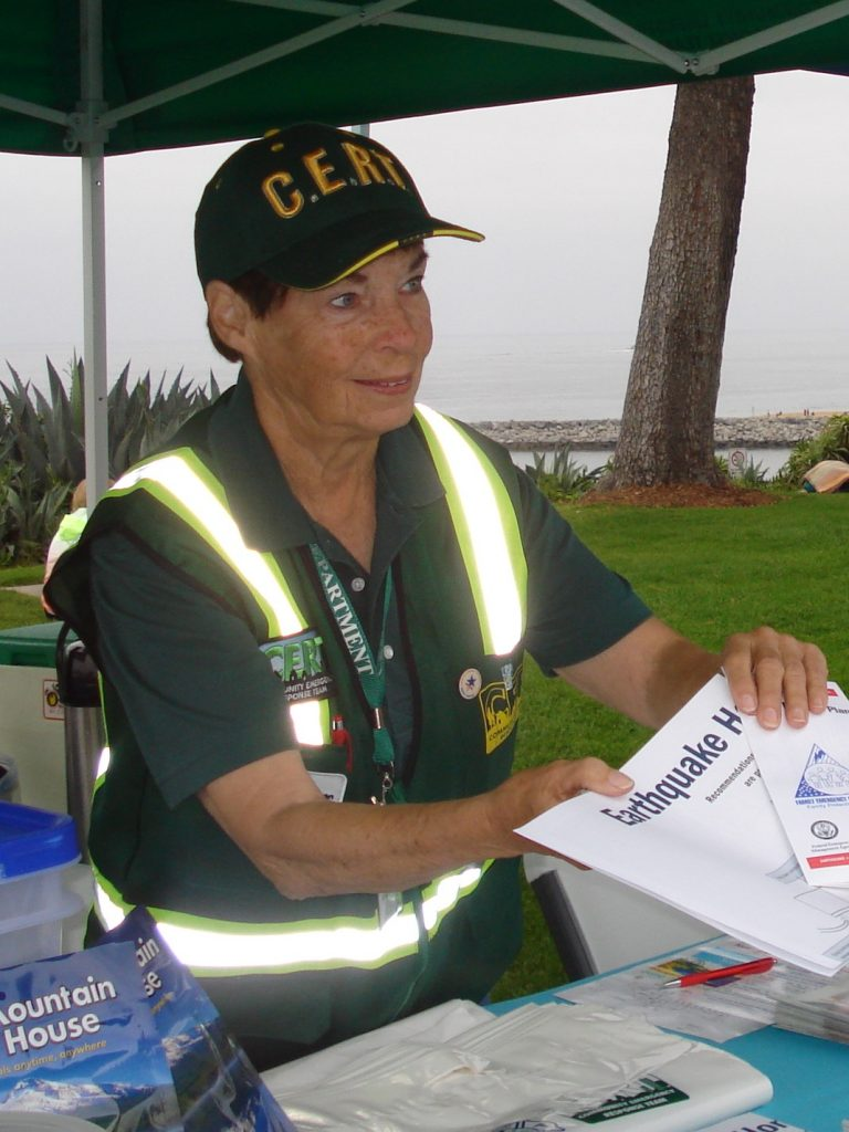 Marilyn Broughton helps residents at a Community Emergency Response Team event. — Photo courtesy Newport Beach Fire Department ©