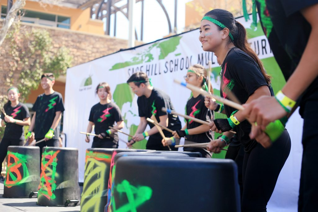 Sage Hill students Josh Lee, Albert Son, Justin Sung, Mary Shin, Sarah Kim, Ashley Chung, Stephanie Yang, Daniel Min, Alex Kwon, and Yuna Baek, perform Korean Nanta, incorporating dance and drums. — Photo by Sara Hall ©