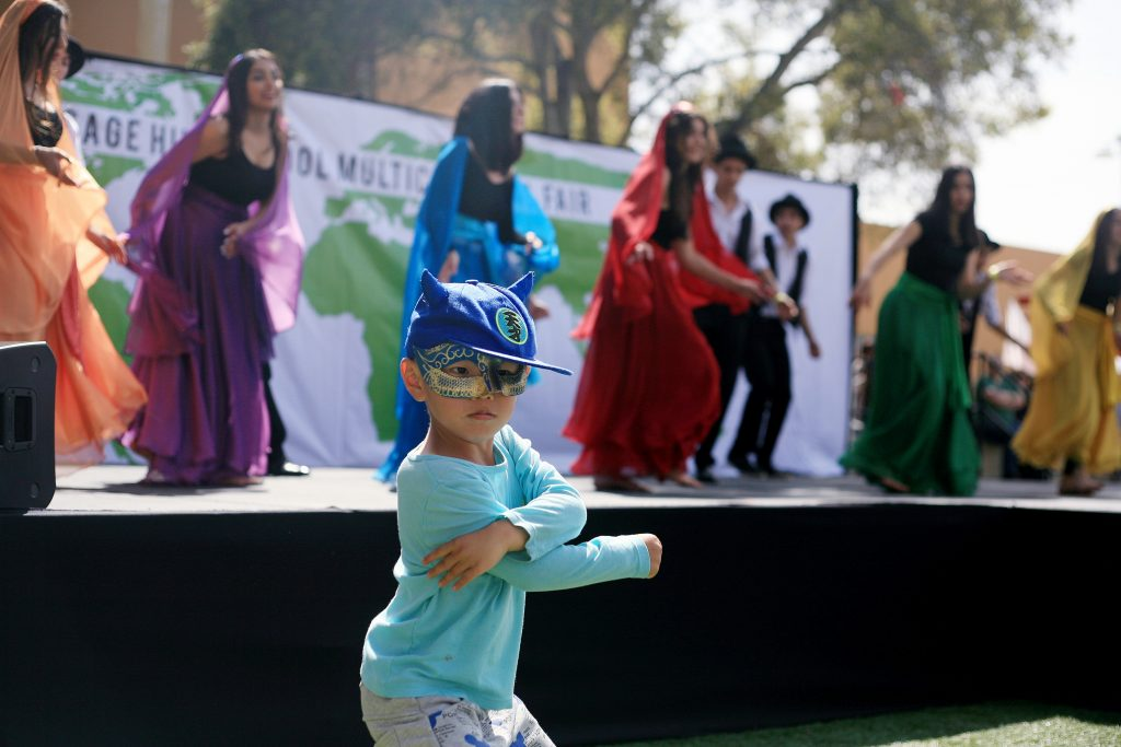 Robert Luo, 4, dances along with Sage Hill students and Persian dancers Sahar Rohani, Sahar Emtiaz, Ava Kahn, Sarah Takallou, Arianna Dominic, Kianna Dominic, Ava Emami, Pirooz Pezeshpour, Arman Ramezani, Sallar Tahbaz, Iman Amini, Arya Aydin and Ryan Hosseinzadeh. — Photo by Sara Hall ©