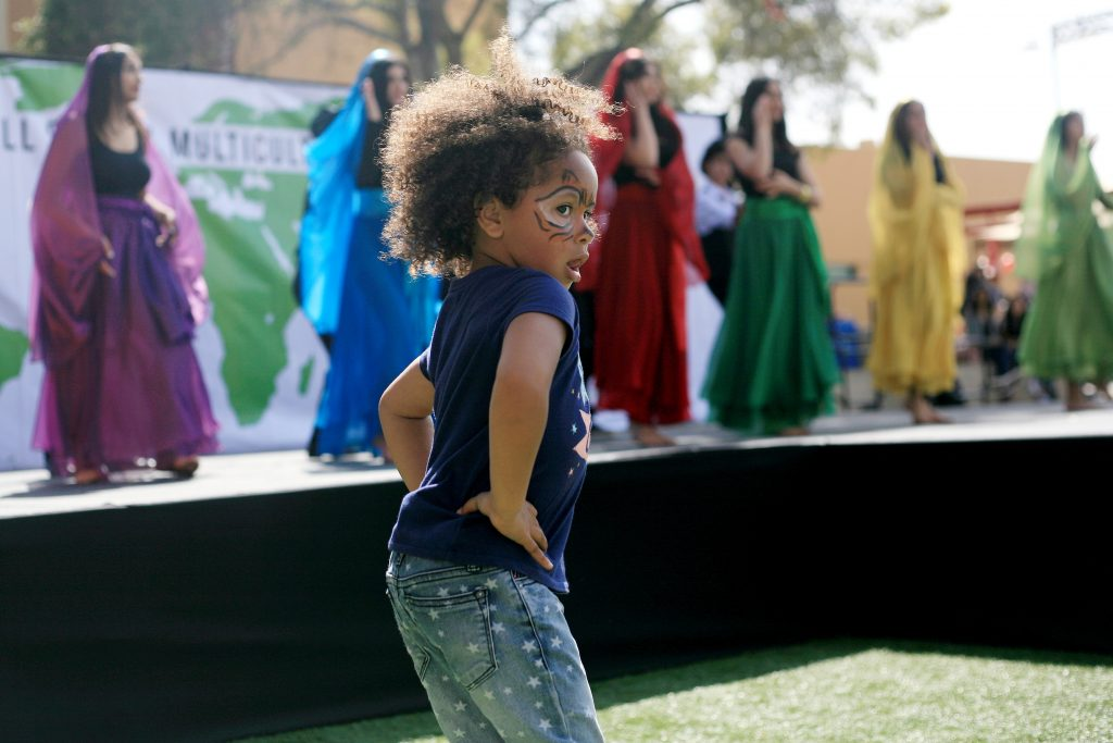 RiKayla Dillingham, 4, dances along with Sage Hill students and Persian dancers — Photo by Sara Hall ©