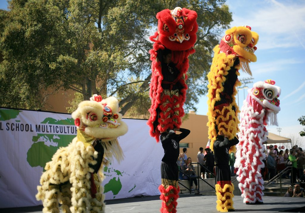 Ane Thanh's Chinese Lion Dancers perform on stage at the 16th Annual Sage Hill School Multicultural Fair on Saturday. — Photo by Sara Hall ©