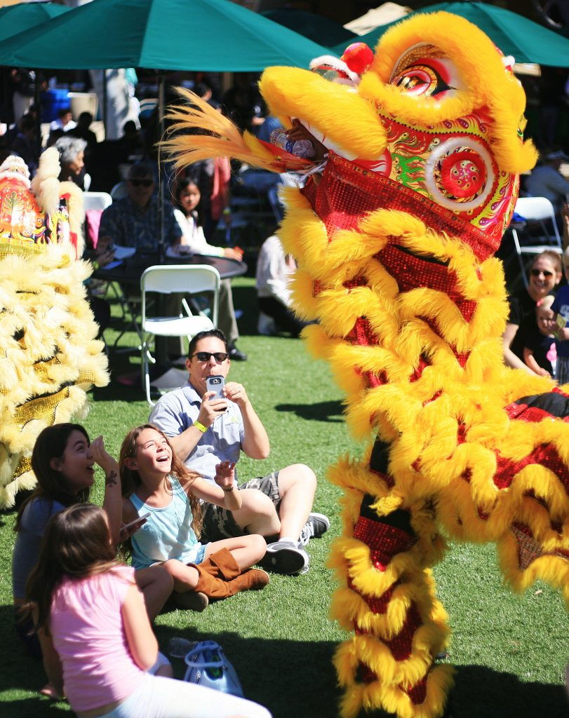 Members of Ane Thanh's Chinese Lion Dancers interact with the crowd at the 16th Annual Sage Hill School Multicultural Fair on Saturday. — Photo by Sara Hall ©