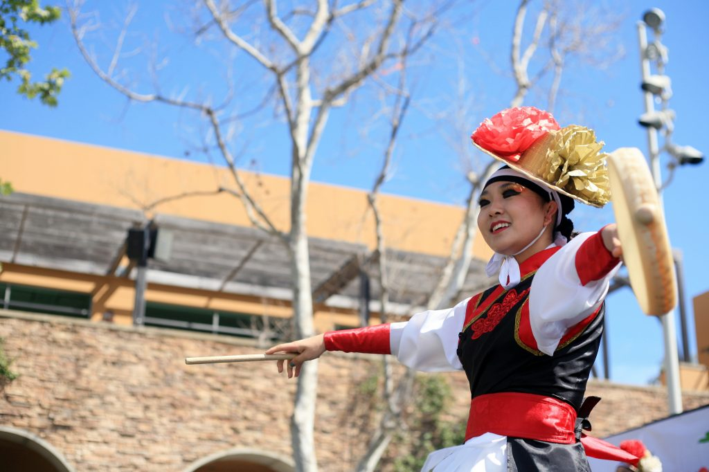 A KAYPA member performs a Korean traditional drum dance at the Multicultural Fair. — Photo by Sara Hall ©