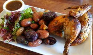 Half chicken with fingerling potatoes at Moulin