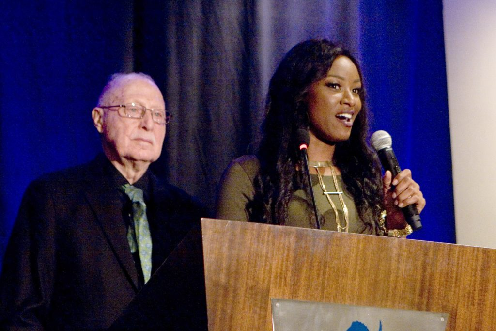 Olive Crest Co-Founder Dr. Donald Verleur, Roshaunda Crain, former Olive Crest youth and Shining Star Award recipient