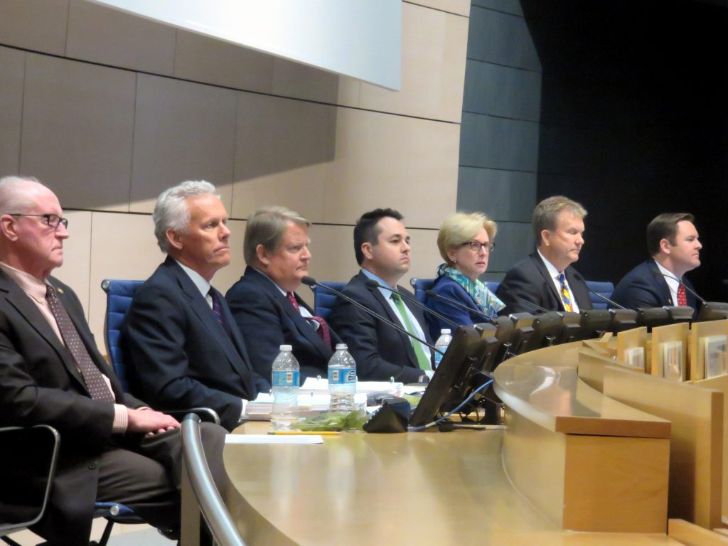 "Members of the Newport Beach City Council (left to right) Jeff Herdman, Brad Avery, Mayor Pro Tem Marshall ""Duffy"" Duffield, Mayor Kevin Muldoon, Diane Dixon, Scott Peotter, and Will O'Neill  listen as residents explain their reasons for a recall effort of Peotter. — Photo by Sara Hall ©"