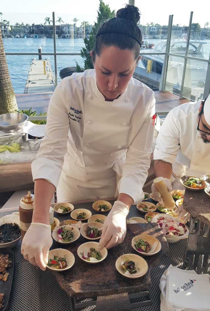 Chef Rachel Haggstrom prepares cuisine for the Honors Reception at Balboa Bay Resort