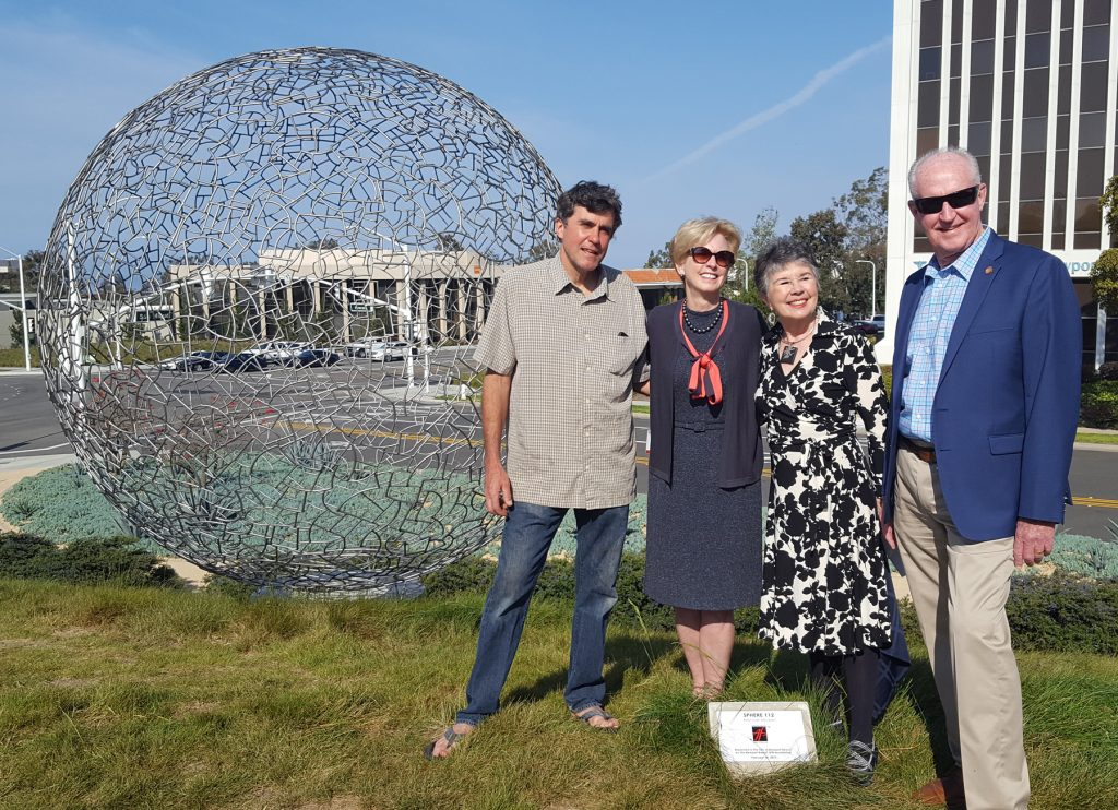 (left to right) Artist Ivan McLean, Newport Beach City Councilwoman Diane Dixon, NB Arts Foundation President Carmen Smith, and City Councilman Jeff Herdman pose for a photo in front of the Sphere 112 at the dedication ceremony on Tuesday. — Photo by Christopher Trela ©