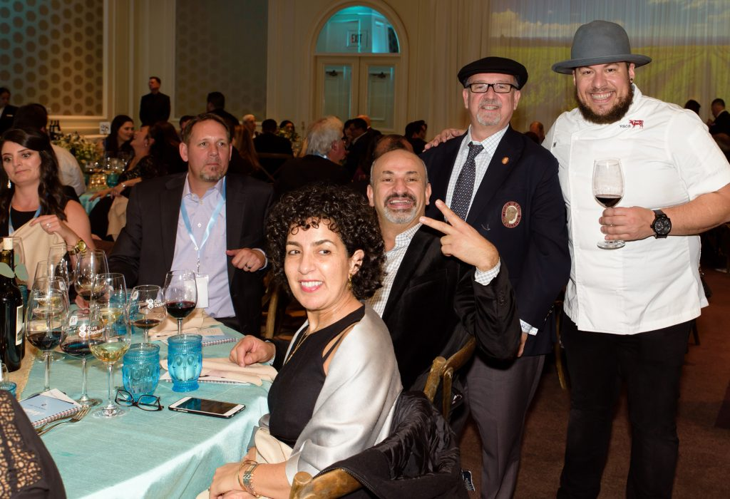 Wine curator Michael Jordan and Chef Amar Santana (standing) with guests