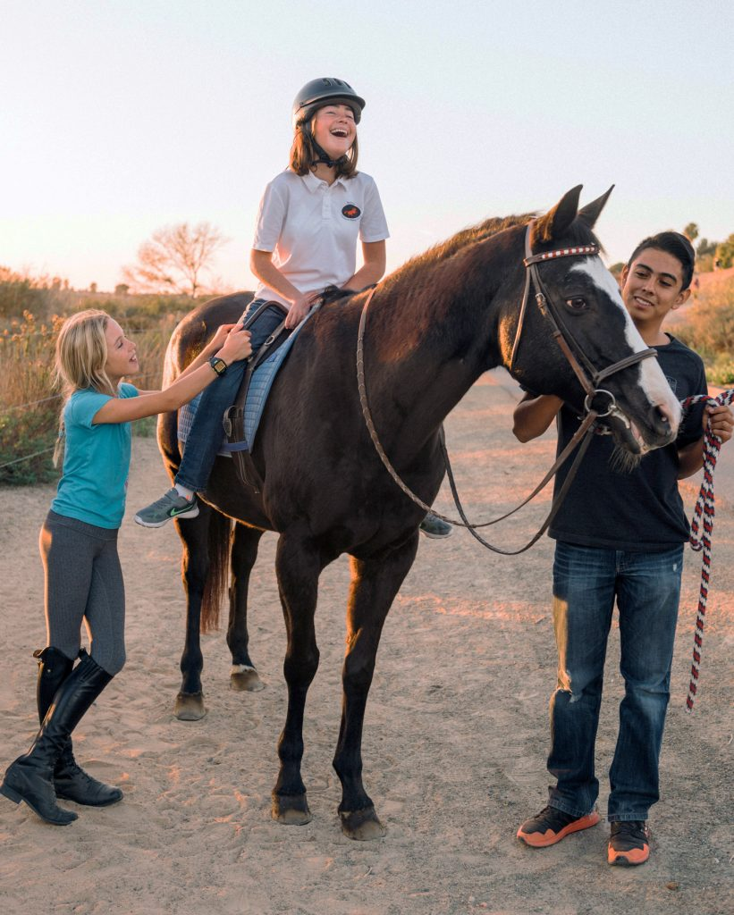 Kids enjoy riding a horse at the Back Bay Therapeutic Riding Club. — Photo courtesy BBTRC ©