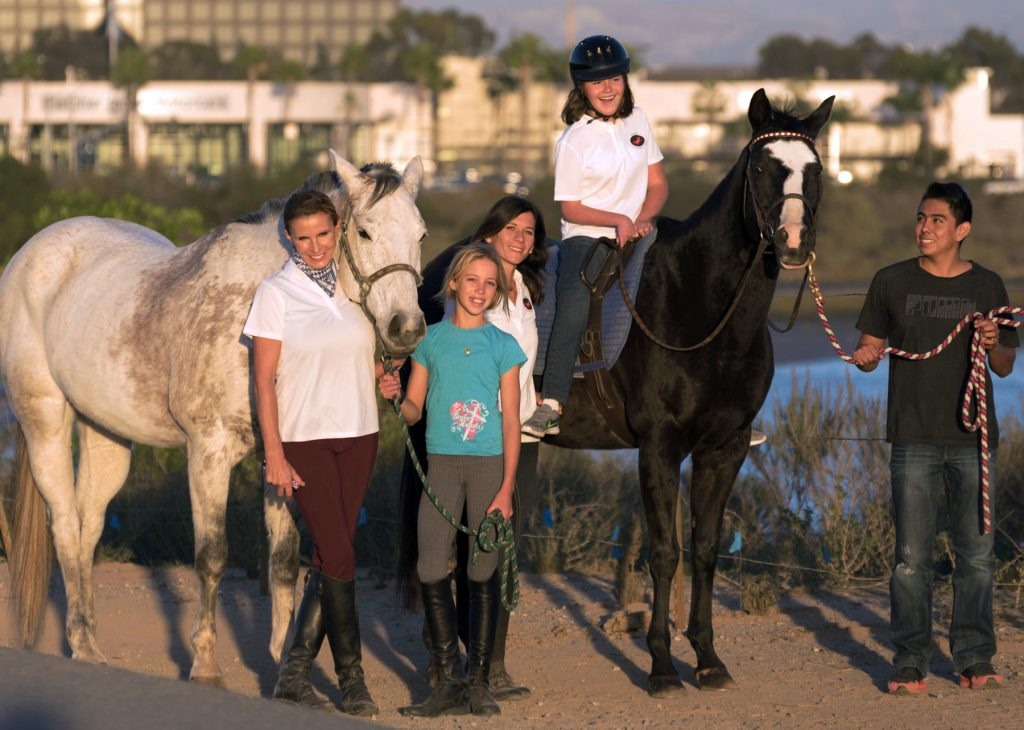 Bernadette Olsen (far left) and members of the Back Bay Therapeutic Riding Club. — Photo courtesy BBTRC ©