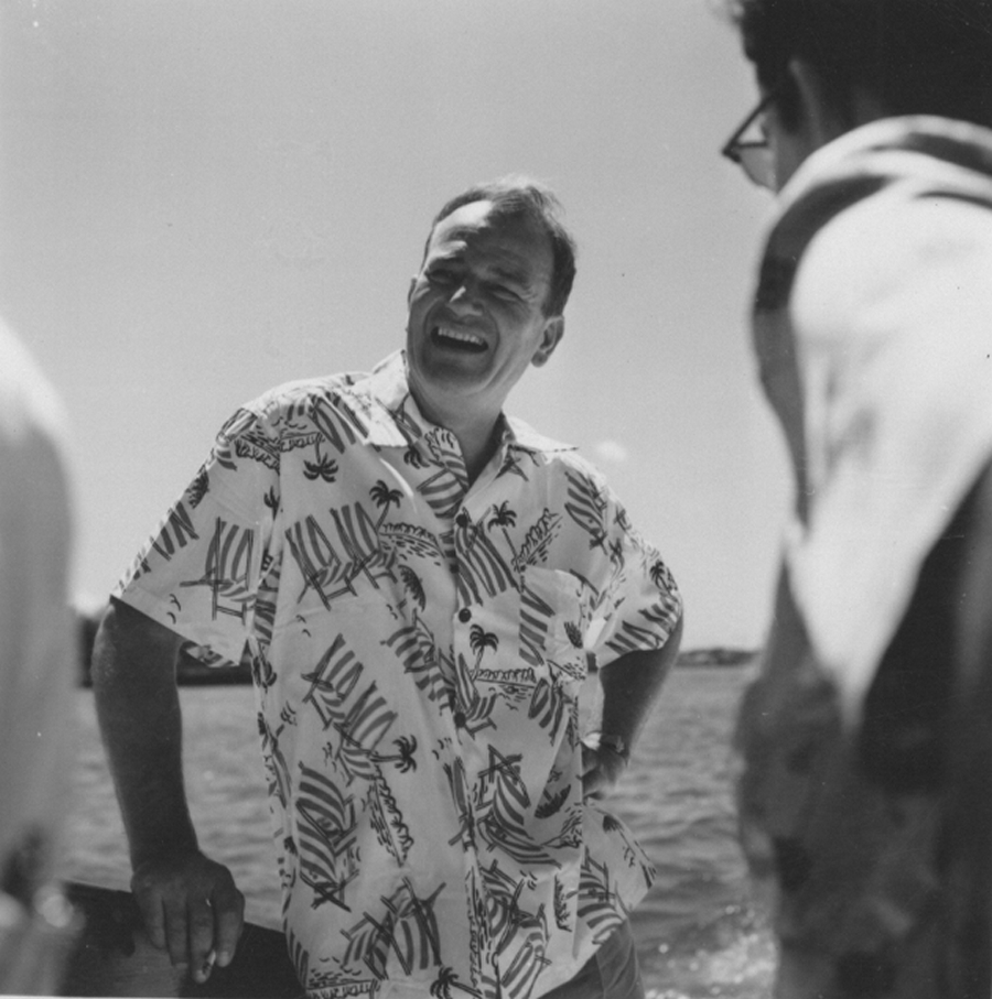 John Wayne casually dressed and enjoying time aboard his boat, the Wild Goose, with friends and family. — Photo courtesy John Wayne Enterprises ©