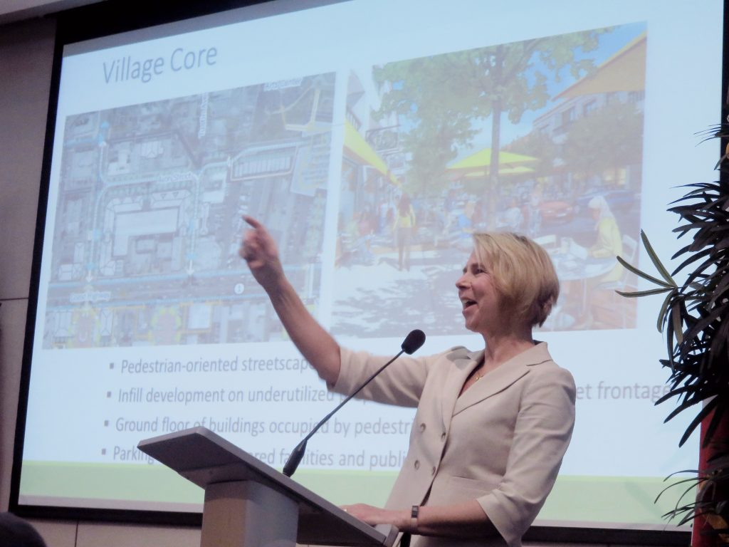 Kim Brandt, the city's community development director, speaks to the crowd at the Newport Beach Chamber of Commerce's monthly Wake Up! meeting on Thursday about Mariners' Mile Master Plan, the Balboa Peninsula Trolley, and short-term vacation rentals.  — Photo by Sara Hall ©