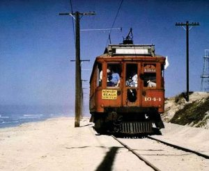 An old Red Car trolley making its way along the coast