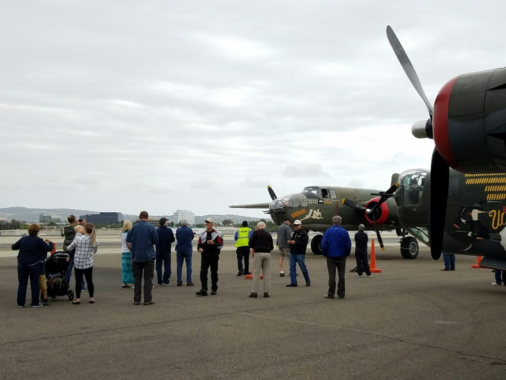The crowd watches some of the historic planes on Wednesday. — Photo by Jim Collins ©