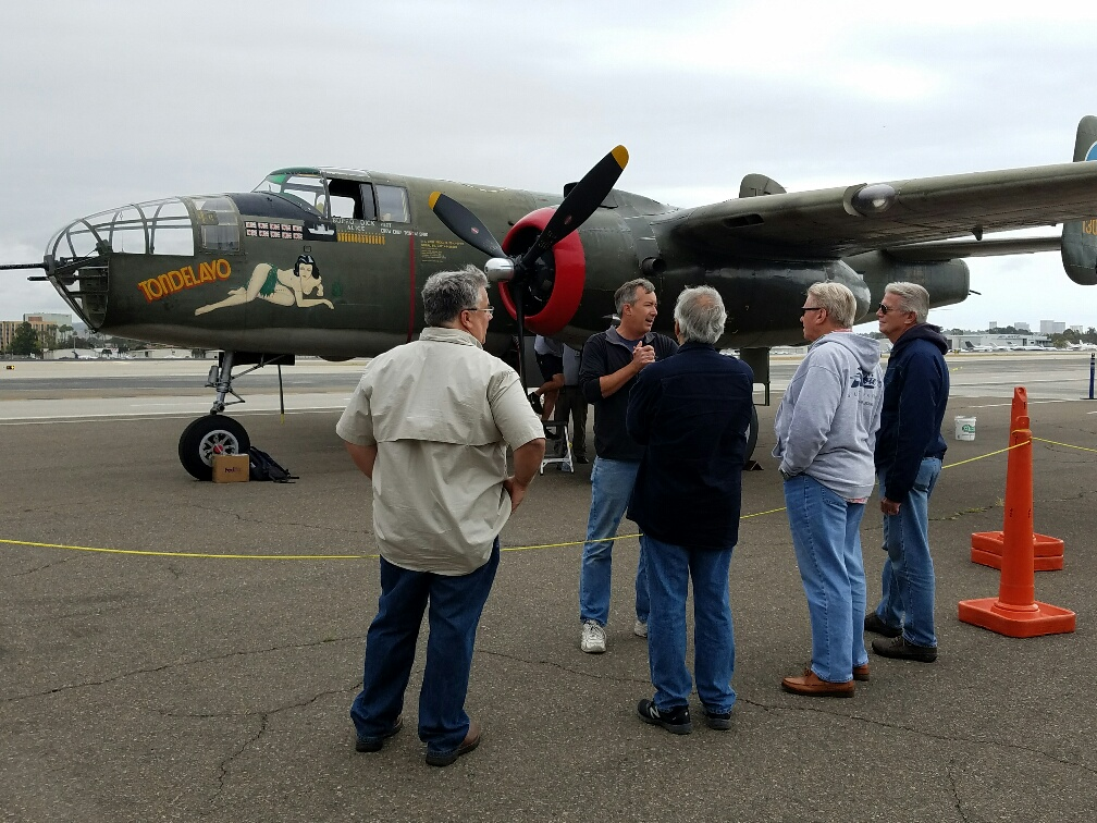 A Lyons Air Museum volunteer talks to guests about the flight experience with the Collings Foundation Wings of Freedom Tour. — Photo by Jim Collins ©