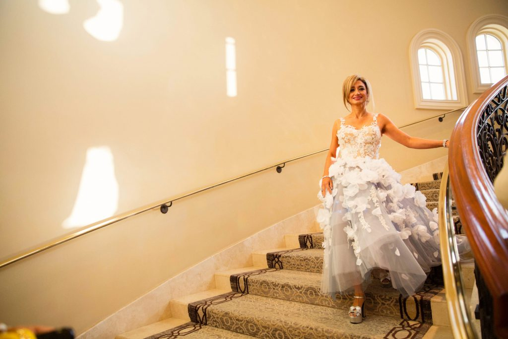 Leila Rasouli MD of Newport Coast, a Saddleback Memorial Foundation Board Member and Bronze Sponsor, descends the staircase to enter the gala.
