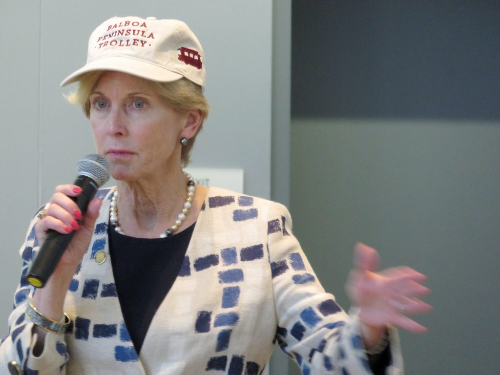 Newport Beach Councilwoman Diane Dixon talking at the Speak Up Newport meeting on Wednesday while wearing a Balboa Peninsula Trolley hat.  — Photo by Sara Hall ©