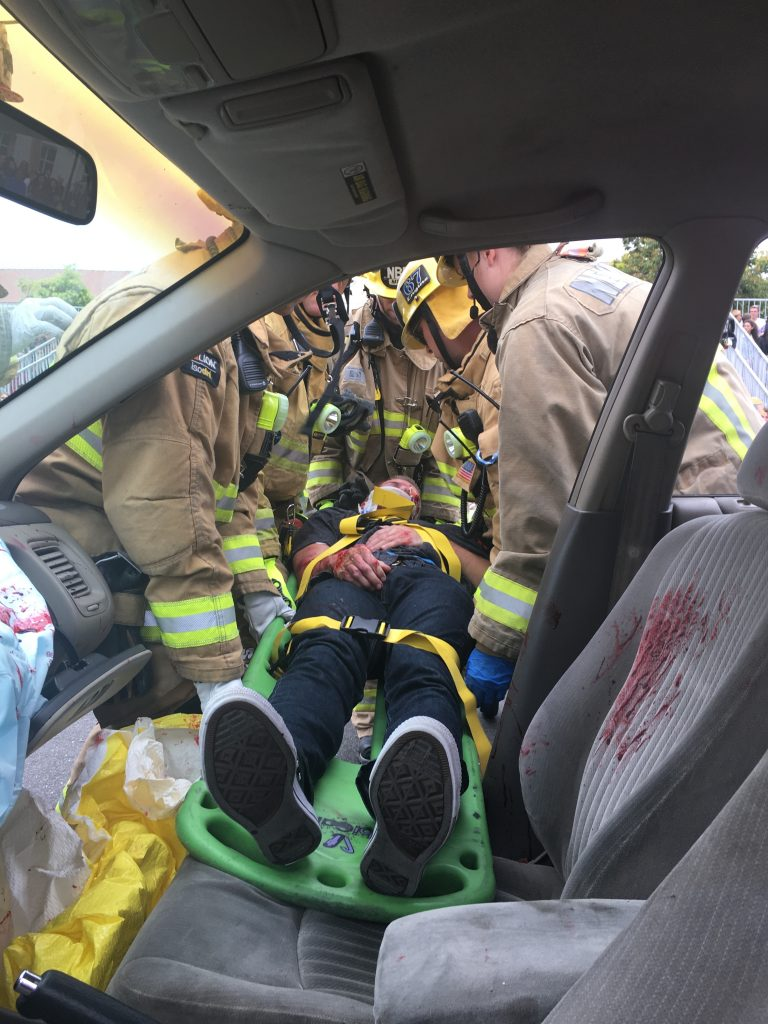 "A student participant is removed from a vehicle during the ""Every 15 Minutes"" simulated crash on Wednesday.  — Photo courtesy of Newport Beach Fire Department ©"