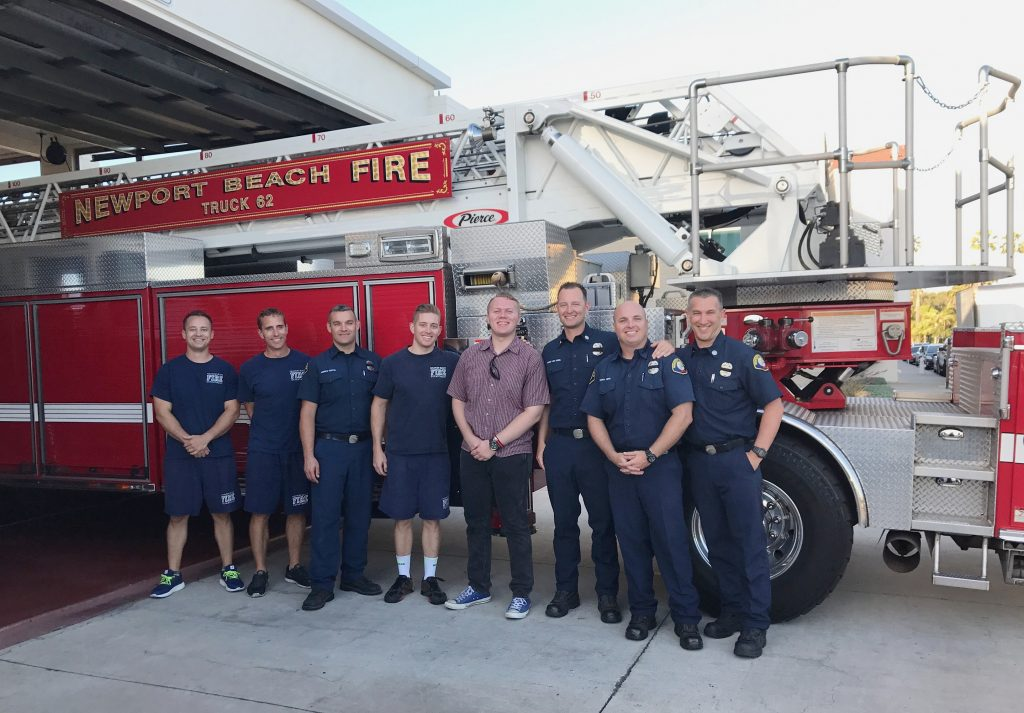 Dominic Laffoon, 18, stands with members of the Newport Beach Fire Department during his Make-A-Wish wish reveal recently at the Lido Isle station.  — Photo courtesy Make-A-Wish Orange County and the Inland Empire ©