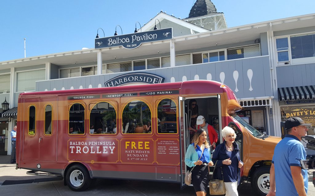 Passengers disembark from the Balboa Peninsula Trolley