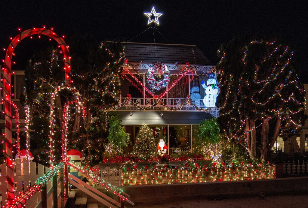 Geof Wickett and Norm Lessard's home on E. Bay Front on little Balboa Island  is one of many houses decorated for the holidays in Newport Beach and ... - Newport Beach Local News Ring Of Lights Homes Feature Festive Décor