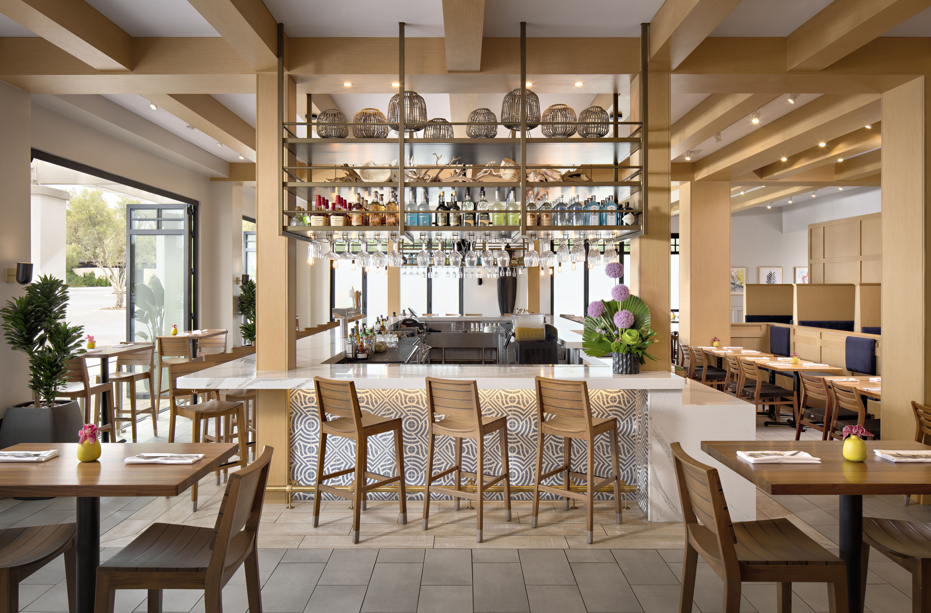 Tommy bahama returns fleming s tastes the future - Interior design school newport beach ...